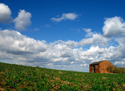 An old, abandoned red brick barn on top of Meon Hill